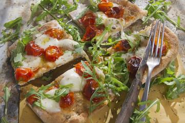Pizza with tomato and arugula