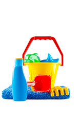 Children's toys bucket, spade, sunscreen and towel on white back