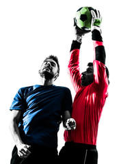 two men soccer player goalkeeper catching heading ball competiti