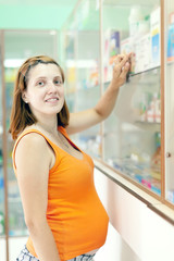 pregnant woman  at the pharmacy drugstore