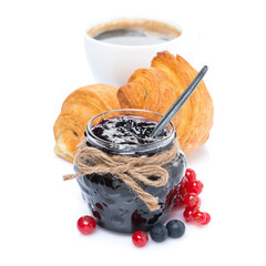 jam, fresh berries, croissants and cup of coffee, isolated