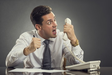 Furious businessman shouting on phone