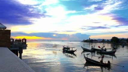 fishing boats bobbing in the sea at sunset, fishermen preparing