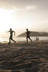 Kids playing football on the beach #3