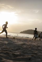 Kids playing football on the beach #2