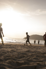 Kids playing football on the beach #1