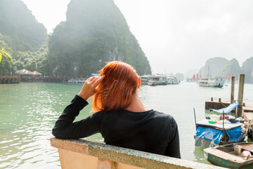 Young woman enjoying Halong bay view