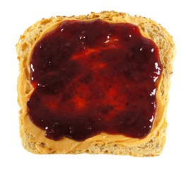 Isolated slice of bread with peanut butter and jelly spread