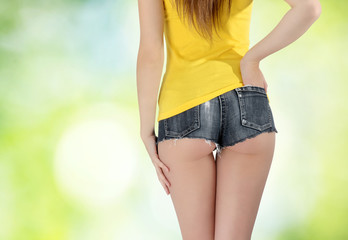 ass woman wearing a short denim shorts