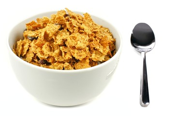 Bowl of bran flakes cereal with spoon
