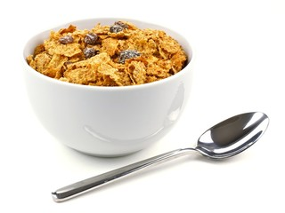 Bowl of bran flakes and raisin cereal with spoon