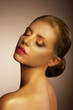 Artistry. Bronzed Woman's Face. Futuristic Art Gold Makeup