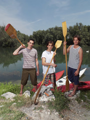 Young men with kayaks