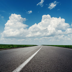 clouds on blue sky over asphalt road