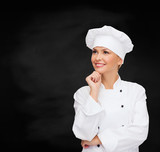 smiling female chef dreaming - 66399601