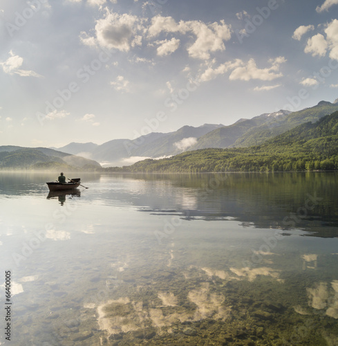 angler on the boat, the Slovenian lake Bochinjskie © Mike Mareen