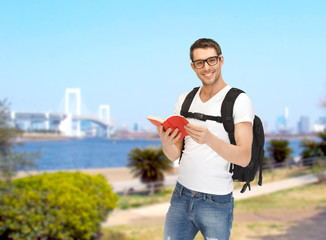 travelling student with backpack and book
