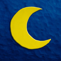 Color children's moon plasticine on a dark blue background