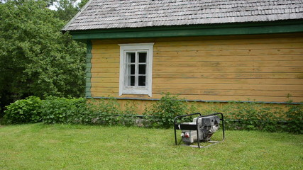 diesel electricity generator work near rural house in village