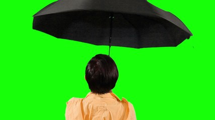 Close-up of a woman opens an umbrella. Green screen.