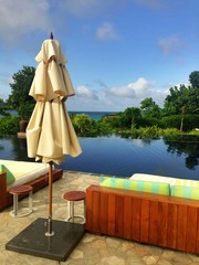 relaxing view by swimming pool at tropical resort in Seychelles
