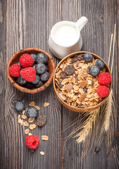 Homemade granola muesli with berries and milk