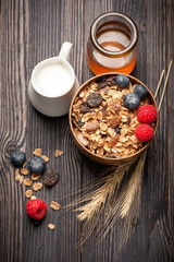 Granola muesli with honey, berries and milk