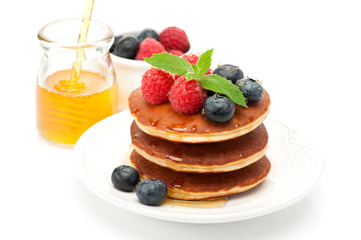 Pancakes. Stack pancakes with raspberries, blueberries and honey
