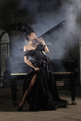 elegant lady with luxurious hairstyle near piano