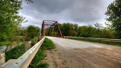 Timelapse of an old iron bridge on a country road