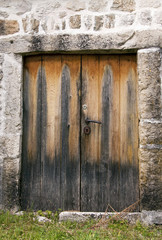 Old wooden door in a stone house