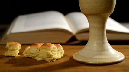 bible with chalice and bread, panning,sliding,
