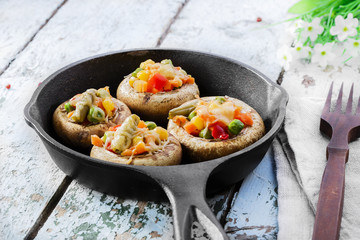 Baked mushrooms with cheese and vegetables