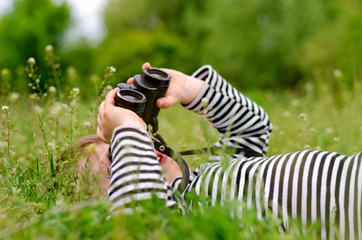 Young child using a pair of binoculars
