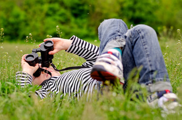 Little boy observing the sky through binoculars