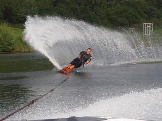 man waterskiing slalom