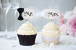 Leinwandbild Motiv Bride and groom cupcakes