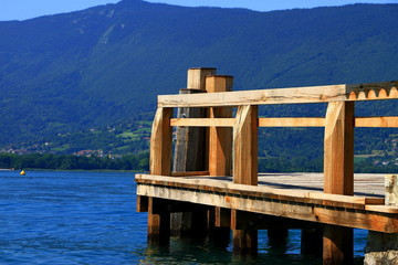 Empty wooden pier on Annecy lake