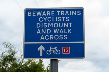 Beware trains cyclists dismount and walk across