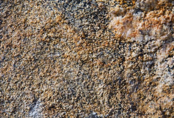 Yellow stone textured granulated background