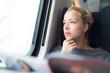 Leinwandbild Motiv Lady traveling by train.