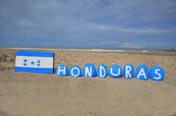 Flag and country name of Honduras on stones