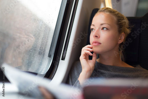Foto op Canvas Treinstation Lady traveling by train.