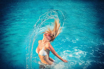 blonde woman at the swimming pool