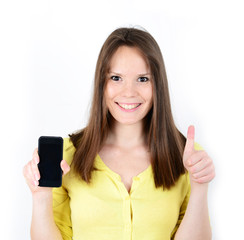 Beautiful woman showing a smart phone with thumb up isolated on