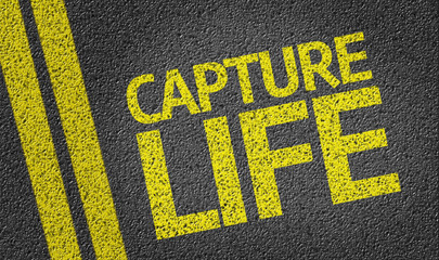 Capture Life written on the road