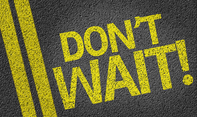 Don't Wait written on the road