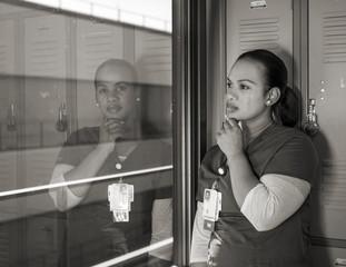 beautiful sad African American nurse crying