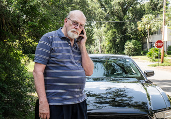 Angry Senior Man with Roadside Car Problems