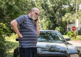 Frantic senior man calls for roadside assistance with car breakd